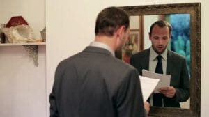 stock-footage-young-businessman-practice-his-speech-in-front-of-mirror