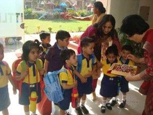 teacher giving sweets