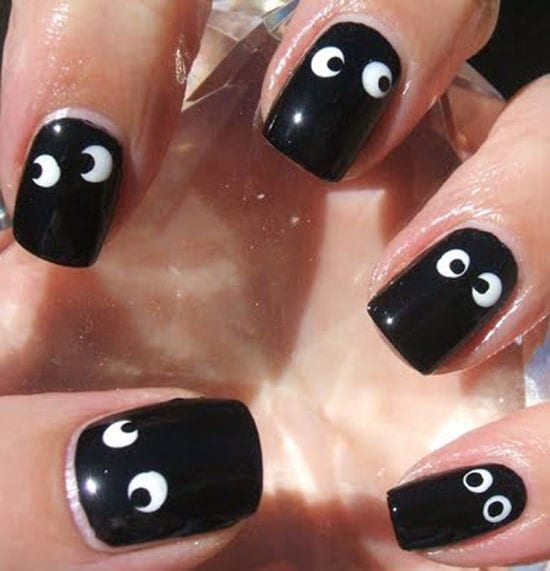 These adorable eyes will take you less than 10 minutes to perfect. Paint  your nails black, put white dots with the head of a pin, and then draw the  eyeballs ... - 30 Easy And Unique Nail Art Ideas And Designs - Listaka