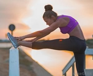 woman-stretching-during-sunset