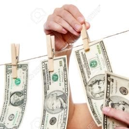 Hand pinch money on clothes line isolated on white background