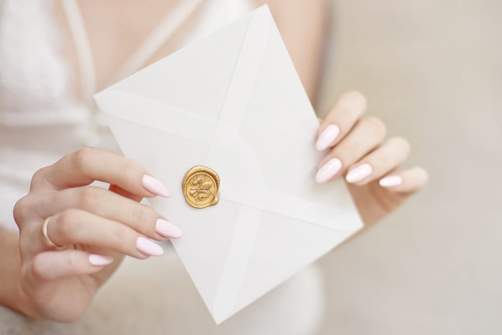 Best Tips for A wedding on a Budget: do your own invitations