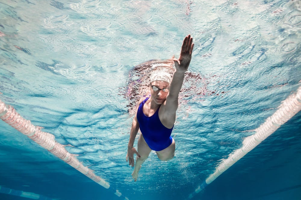 Best Swimming Benefits - It improves strength and definition